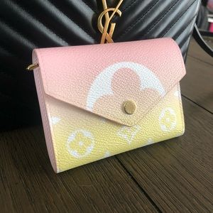 Victorine by the Pool Louis Vuitton Pink wallet!